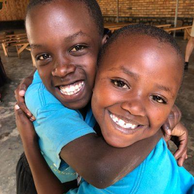 Acts4Rwanda Sponsor Girls Hug
